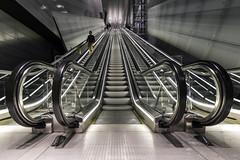 Noord/Zuidlijn Vijzelgracht escalator (Dannis van der Heiden) Tags: escalator noordzuidlijn subway amsterdam metro station lines ceiling netherlands entrance exit nikond750 d750 tokina1628mmf28 symmetry people reflection lights floor