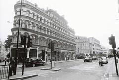 London (goodfella2459) Tags: nikonf4 afnikkor24mmf28dlens fomapanprofilineclassic100 london city streets road buildings cars bwfp