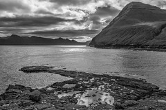 Gjogv evening (Marion McM) Tags: esturoy gjogv kalsoy faroes faroeislands mountains sky clouds evening rocks reflections blackandwhite monochrome landscape canoneos760d