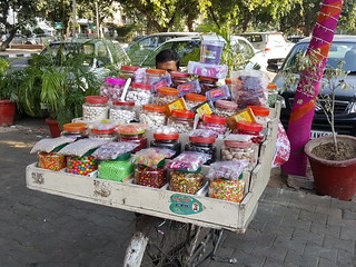 An itinerant vendor selling candy and confections
