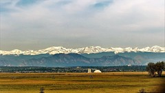 Colorado Spring (Jan Nagalski (catching up)) Tags: snowcaps rockymountains grassland foothills city colorado spring jannagalski jannagal irrigator dryfield drygrass tree trees mountainpeak overcast heavyovercast