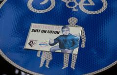 """Watford FC Shit On Luton"" (IFM Photographic) Tags: img5739a canon 600d sigma70200mmf28exdgoshsm sigma70200mm sigma 70200mm f28 ex dg os hsm watford hertfordshire herts watfordfootballclub watfordfc lutontownfootballclub lutontownfc shitonluton eltonjohn sireltonherculesjohn reginaldkennethdwight toilet shitting art sticker graffiti sign"