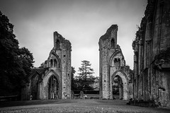 Arches of the past (Anthony P.26) Tags: architecture category decay england external glastonbury glastonburyabbey places somerset travel canon1585mm canon70d canon abbey monastery ruin stone stonebuilding structure arches gothicarchitecture placeofworship tower grass lawn trees sky greysky cloudy mono monochrome blackandwhite whiteandblack bw outdoor travelphotography