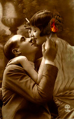 Light My Fire: In the 1920's, the glamour associated with cigarette smoking played a huge role in nascent romance. (Fotofricassee) Tags: hair romance fire cigarette couple woman man lovers