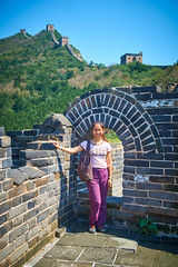 2018 Beijing - 司马台长城 (Si Ma Tai Great Wall) 089 (ArdieBeaPhotography) Tags: ruins broken stone rubble tall rugged mountains sky clouds high summer wall great simatai tourists walking 司马台 长城 woman arch masonry standing pose battlements hilltop background