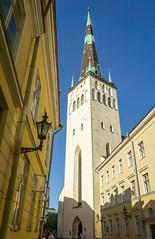 Oleviste's tower and spire (Tiigra) Tags: tallinn harjucounty estonia ee 2018 architecture church city cross gothic lantern oleviste portal repetition rhythm spire tower window arch pattern