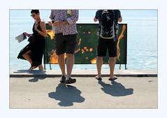 a game of patience (overthemoon) Tags: switzerland suisse schweiz svizzera romandie vaud vevey veveyimages biennaledesartsvisuels feuaulac lenticularimagery philippedurand frame people shadows spectators artinstallation hairylegs headscutoff shortshadows
