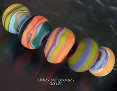 Oldies but Goodies Donuts (Laura Blanck Openstudio) Tags: openstudio openstudiobeads glass handmade lampwork murano beads set made usa fine arts jewelry art artist artisan whimsical funky odd colorful multicolor abstract asymmetric earthy organic bohemian boho matte opaque frosted gypsy etched glow glowing nuggets ruedas rueditas donuts rounds lines stripes green orange blue ocher chartreuse kiwi parrot mango lapis violet purple lilac lavender coral emerald teal pea lime