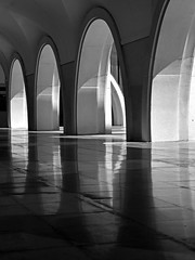 Santuari de Meritxell (RobertLx) Tags: meritxell andorra pyrenees europe architecture building arch column contrast dark monochrome bw cult shadow sanctuary arcade black church