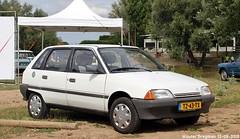 Citroën AX 11 RE 1989 (XBXG) Tags: tz43tx citroën ax 11 re 1989 citroënax blanc white 99 jaar 99jaarcitroën eiland van maurik 2018 buren betuwe gelderland nederland holland netherlands paysbas youngtimer old classic french car auto automobile voiture ancienne française vehicle outdoor