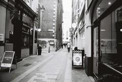 London (goodfella2459) Tags: nikonf4 afnikkor24mmf28dlens fomapanprofilineclassic100 35mm blackandwhite film analog london city street streets buildings bwfp