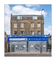 Relocated, East London, England. (Joseph O'Malley64) Tags: relocated moved closeddown closedforbusiness shutdown businesspremises shop formershop shopfront frontage georgianbuilding brickwork bricksmortar cement pointing repairs rebuilding bombdamage worldwartwobombdamage drainpipes slateroof slateroofingtiles windows sashwindow netcurtains bannersigns signs signage steelpanelling steelpanels steelsecuritydoor secured security lamppost streetlighting signpost buildings building structure wall walls pavement accesscovers granitekerbing blockpaving tarmac roadmarkings cctv cctvcamera observation survaillance urban urbanlandscape fujix fujix100t accuracyprecision