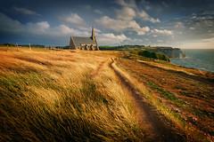 THAT SUNRISE (toksikosmos) Tags: ifttt 500px landscapes etretat france beach cliffs sunrise yellow wind church sacred leading lines clouds skies fine art luminosity europe seascape
