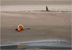 Low tide (Hugh Stanton) Tags: buoy post beach refelection