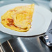 Dish Of Omlette With Ham And Tomatoes