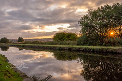 SJ1_0435 - Shades of Autumn (SWJuk) Tags: swjuk uk unitedkingdom gb britain england lancashire burnley home canal leedsliverpoolcanal straightmile water still calm reflections towpath sunrise dawn daybreak sun sunlight sunburst golden colourful clouds sky skies trees 2018 sep2018 summer autumn nikon nikond7200 d7200 18300mm rawnef lightroomclassiccc