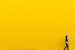 Girl walking wall - Credit to https://homegets.com/ (davidstewartgets) Tags: girl walking wall whitespace woman yellow
