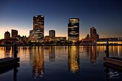 A Milwaukee Golden Hour (In Wonder Photo) Tags: skyline water reflections blue gold architecture harbor milwaukee wisconsin lakemichigan nikon d850 markadsit