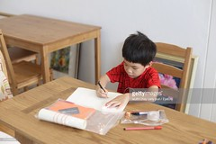 771534429 (pockethifi) Tags: onepersoneducationelementaryagechildhoodpencildaytablei oneperson education elementaryage childhood pencil day table indoors paper realpeople chair boys drawing casualclothing people homeinterior innocence writing 45years horizontalimage