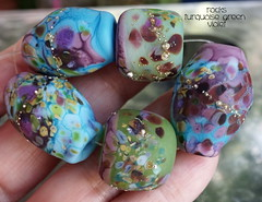 Rocks Turquoise Green Violet (Laura Blanck Openstudio) Tags: openstudio openstudiobeads glass handmade murano lampwork beads set jewelry rocks nuggets pebbles stones whimsical funky odd colorful multicolor abstract asymmetric earthy organic sterling silver silvered fine arts art artist artisan made usa violet purple grape eggplant plum mauve lilac lavender ocher matte etched frosted opaque glow glowing turquoise aqua blue green opal raku orquid fuchsia maroon chartreuse lime parrot kiwi pistachio ocean burgundy rounds donuts
