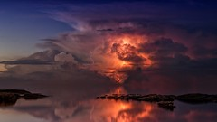 Reflection of Clouds on Body of Water (toptenalternatives) Tags: calm clouds dawn dramatic dusk evening horizon lake landscape light mirror nature ocean outdoors reflection rocks scenic sea seascape seashore silhouette sky storm summer sun sunrise sunset travel water