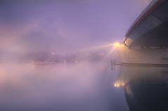 Gradually fading (Maurizio Fecchio) Tags: fog night nikon shot atmosphere travel tranquility bridge lights water industrial landscape lagoon