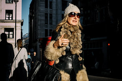 Glam (markfly1) Tags: soho candid woman walking glamorous winter clothes faux fur coat black leather bag beige brown hat bright sunshine silhouetted people shadows passers by buildings cityscape shot urban landscape nikon d750 35mm prime manual focus lens red letter box post