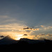 Dramatic sunset behind volcanoes