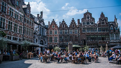 2018 - Belgium - Gent - St-Veerleplein Square (Ted's photos - For Me & You) Tags: 2018 belgium cropped ghent nikon nikond750 nikonfx tedmcgrath tedsphotos vignetting ghentbelgium umbrellas streetscene street restaurant cafes seating seats buildings patio patiodining stveerleplein