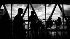 The Waiting Room (Alfred Grupstra) Tags: people silhouette groupofpeople discussion men women talking blackandwhite business focusonshadow backlit blackcolor meeting teamwork urbanscene reflections