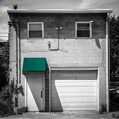 Green Awning (tim.perdue) Tags: green awning building door garage windows black white color cinder block wall back alley uptown westerville ohio light shadow