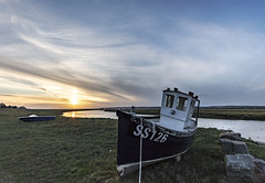 Boat at Penclawdd (Jo Evans1- trying to catch up - again!) Tags: penclawdd gower boat moored river sunset clouds scudding across sky wide angle lens