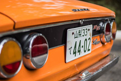 Orangefarbener Mazda-Oldtimer (marcoverch) Tags: car back lights classic carplate orange mazda orangefarben mazdaoldtimer oldtimer vehicle fahrzeug auto noperson keineperson transportationsystem transportsystem race rennen autoracing autorennen traffic derverkehr drive fahrt outdoors drausen road strase stopmoving nichtbewegen competition wettbewerb daylight tageslicht gasoline benzin signalise signalisieren industry industrie travel reise plastic kunststoff safety sicherheit one ein abandoned day coffee design hiking leica natur cityscape flying pentax
