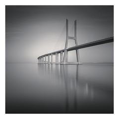 Ponte Vasco da Gama (Vesa Pihanurmi) Tags: bridge vascodagama portugal lisbon river tagus tejo reflection architecture monochrome