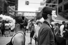 Masked (mfhiatt) Tags: img23540718jpg protest anonymous masks farmersmarket downtownfarmersmarket courtavenue blackandwhite desmoines iowa street streetphotography