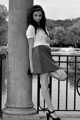 Marissa 102 Mono (TheseusPhoto) Tags: girl female woman model modeling fashion pretty brunette beautiful people portrait portraiture bnw blackandwhite monochrome noir park pond skirt heels railing pose sexy