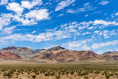 The Hills on US95 in the Nevada Desert Near Beatty. (RStonejr) Tags: whatever flora outside naturephotography landscapebeauty colours new summer2018 summer sunny sun daylight light day countryside getoutandexplore eos stripes amargosavalley amargosa nevadavacation vacation travel rs2pics stone ross rossstone idk pretty desertbeauty hills mountains yellow orange blue sky landandsky colors colorful beauty landscape 24mmf28lens 24mm canon80d 80d canon unofficial flickr shadows shadow clouds cloudy highway95 us95 nevada 2018 nature'sbeauty natur desert hot august2018 august beattynevada beatty