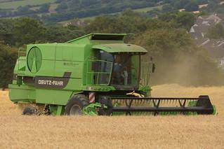 Deutz Fahr 5660 HTS Combine Harvester cutting Spring Barley
