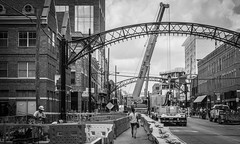 Looking North (tim.perdue) Tags: looking north high street short arts dictrict downtown urban city columbus ohio arches crane construction workers barriers black white bw monochrome equipment truck redevelopment