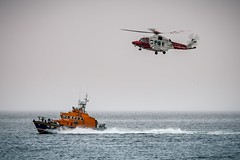 Hover (Leanne Boulton) Tags: boat sea ocean sky water vessel ship scottishinternationalairshow airshow display flight flying helicopter chopper agustawestland aw189 coastguard rescue rnli lifeboat trentclass waves overcast hover hovering tone texture detail naturallight outdoor light shade humanity canon canon5dmkiii ef70200mmf28lisiiusm ef2xextenderiii color colour ayr scotland uk flfrok