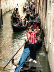 Traffic jam - Venetian style! (Andy J Newman) Tags: venezia portrait man humorous color candid menolympus street humor colorefex italy venice gondolier om humour colour veneto it
