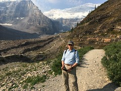 Yours truly on the Plain of Six Glaciers Trail in Lake Louise, Canada (lhboudreau) Tags: canadianrockies rockymountains mountain mountains trail hike hiking landscape grass path sky valley moraine ice snow glacier glaciers mtvictoria plainofsixglacierstrail sixglacierstrail lakelouise banffnationalpark park nationalpark canada alberta trails people outdoor outdoors tree trees pine pines pinetree pinetrees rock rocks mountainside hiker