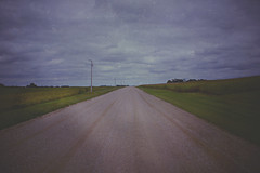 A Dark and Lonely Road (Dave Linscheid) Tags: countryroad gravelroad rural country vignette texture textured mood corn soybeans field agriculture farm watonwancounty mn minnesota usa september cloud landscape