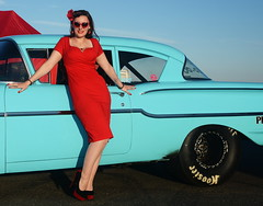 Holly_9242 (Fast an' Bulbous) Tags: classic american car vehicle chevy automobile girl woman hot sexy pinup model long brunette hair red wiggle dress high heels stockings nylons people outdoor sky santa pod