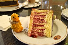 Ducky & a big piece of cake (petrOlly) Tags: europe europa germany deutschland regensburg town city ducky handmade amigurumi crochet planetjune restaurant food foodporn cake coffee