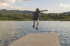 Might As Well Jump (aaronrhawkins) Tags: jump dock lake pond leap air boy child children joshua camp camping aspenlakes hebercity hebervalley utah fall forest fatherandsons float evening aaronhawkins