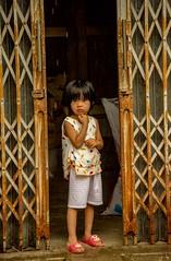 Street Candid, Hanoi (Rod Waddington) Tags: vietnam north hanoi streetphotography street girl doors candid culture cultural child outdoor portrait