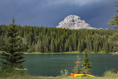 Crowsnest Mountain (Canon Queen Rocks (2,280,000 + views)) Tags: mountain mountainpeak crowsnestmountain greens trees forest sky stormclouds lake chinooklake water nature canada crowsnestpass momentsbycelinecom kayak landscape landscapes scenery scenic