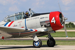 N764BE, T6 Texan, Oshkosh 2018 (ColinParker777) Tags: n764be texan harvard t6 at6 north american piston radial trainer warbird classic geico skytypers skytyper 4 plane airplane aircraft flying taxy taxi flight fly display airshow wave pilot helment eaa experimental association airventure 2018 oshkosh osh kosh canon 7d 7d2 7dmk2 7dmkii 7dii 100400 l lens zoom telephoto pro