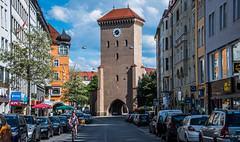 2018 - Germany - Munich - Isator Gate (Ted's photos - Returns Late November) Tags: 2018 cropped germany munich münchen nikon nikond750 nikonfx tedmcgrath tedsphotos vignetting isator isatorgate isatorgatemunich munichisatorgate tower clock clocktower streetscene street vehicles cars bicycle biker bike jackwolkskin umbrella kfc shadow shadows munichgermany munchen münchengermany munchedisatorgate isargate isargatemunich hotel red redrule people peopleandpaths pathsandpeople